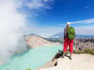 man standing above mount ijen crater