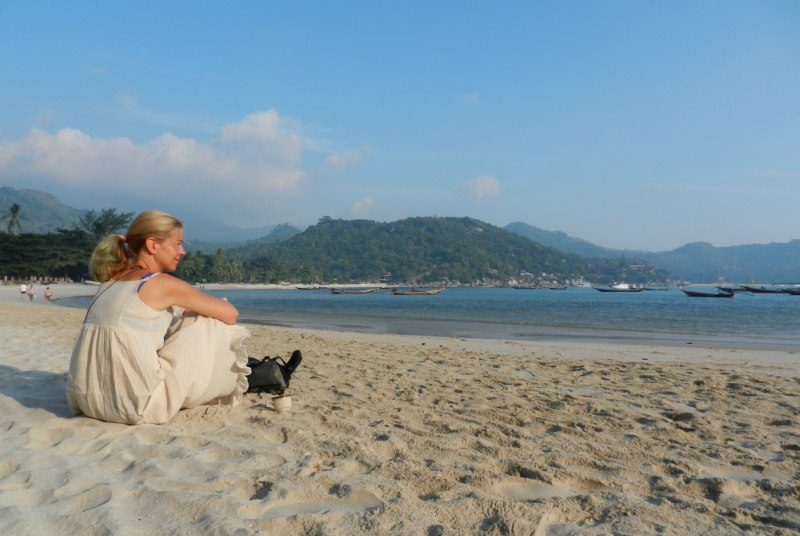 Woman sitting on Ko Phangan sandy beach