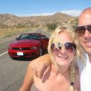 Couple on Joshua Tree road with Mustang