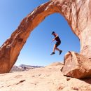 man rock jumping in moab