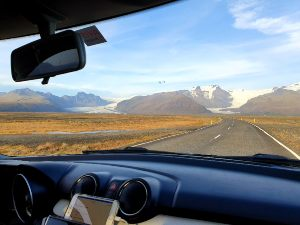 A view of mountains from a car