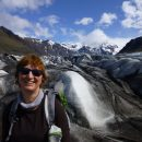 Lady smiling in front of glacier