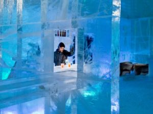 man stands in a hotel made of ice