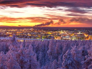 sunset over a snowy city