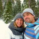 man and woman take selfie in the snow