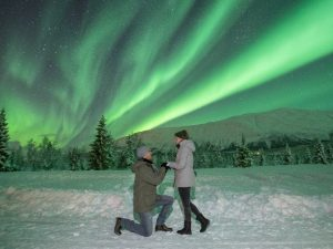 a man proposes to his wife under the northern lights
