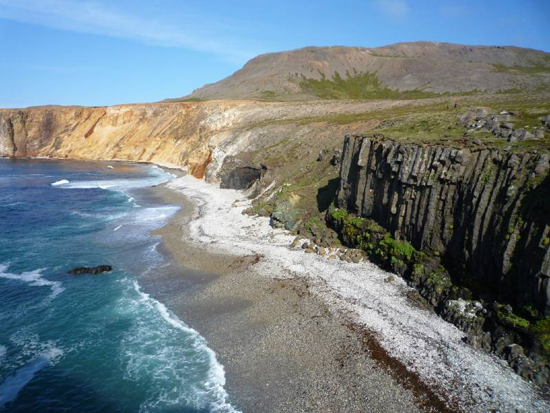 Cliffs with the sea and hills in the background
